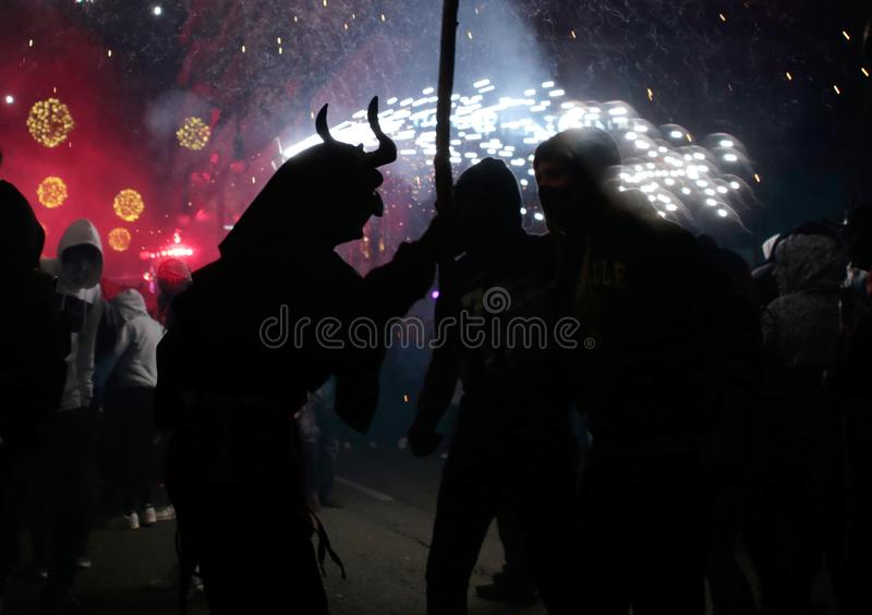Correfoc in palma during saint sebastian local patron festivities. Revellers dressed as devils and holding fireworks take part in a traditional Correfoc fire run stock photo