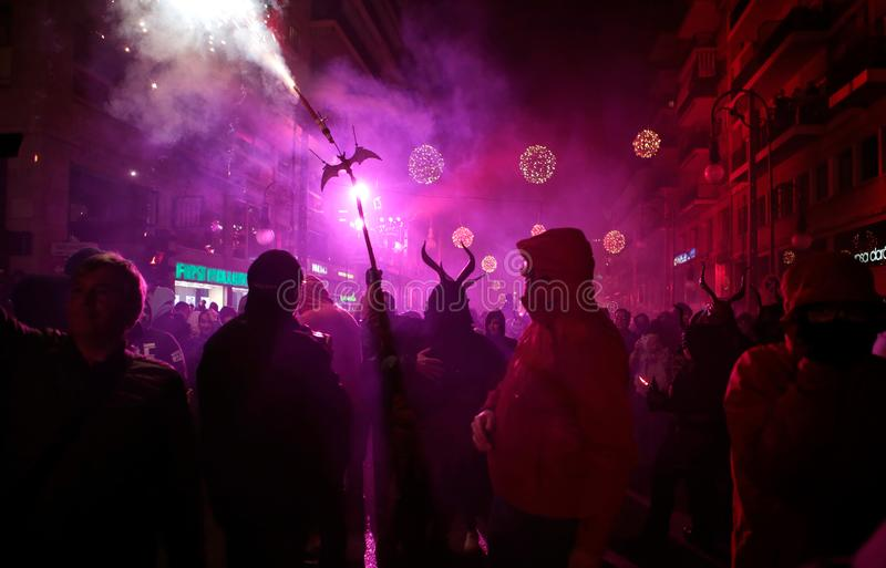 Correfoc in palma during saint sebastian local patron festivities. Revellers dressed as devils and holding fireworks take part in a traditional Correfoc fire run royalty free stock photography