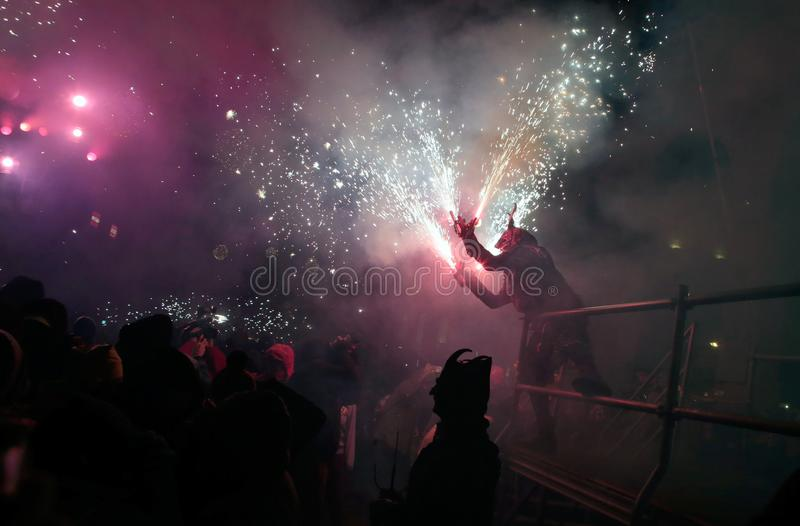Correfoc in palma during saint sebastian local patron festivities. Revellers dressed as devils and holding fireworks take part in a traditional Correfoc fire run royalty free stock photo