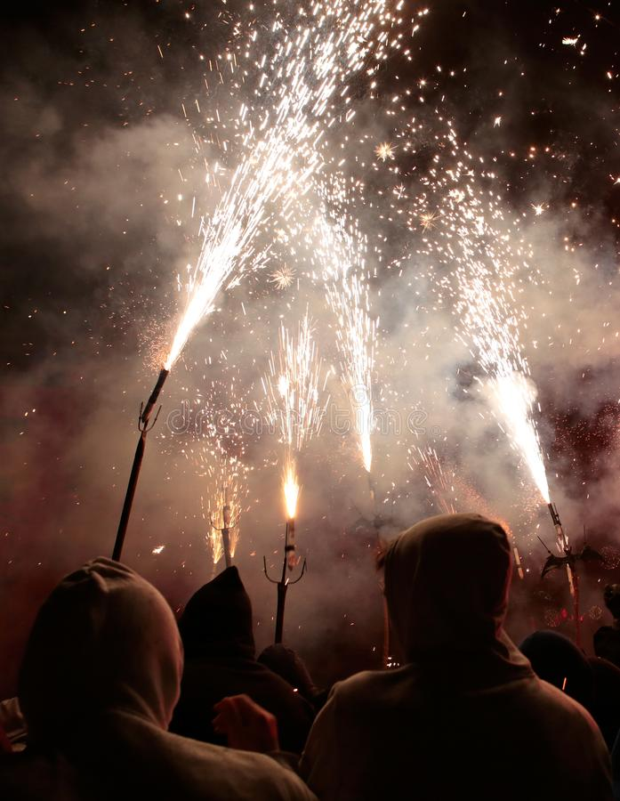 Correfoc in palma during saint sebastian local patron festivities vertical. Revellers dressed as devils and holding fireworks take part in a traditional Correfoc stock images
