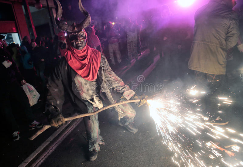 Correfoc sant sebastian 014. Men dressed as devils or evil hords and holding sticks with fireworks seen during a correfoc in the spanish island of mallorca stock images