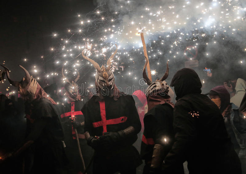 Correfoc sant sebastian 012. Men dressed as devils or evil hords and holding sticks with fireworks seen during a correfoc in the spanish island of mallorca royalty free stock images