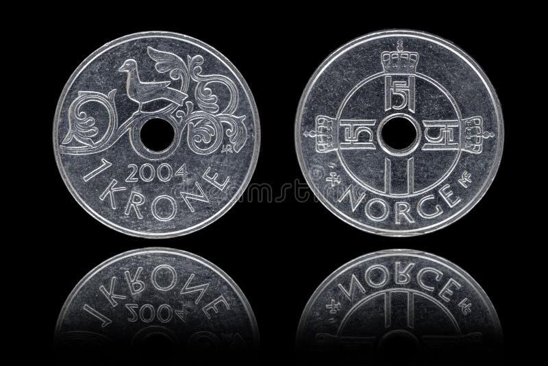 Correspondant et inverse d'une pièce de monnaie de couronne norvégienne images stock