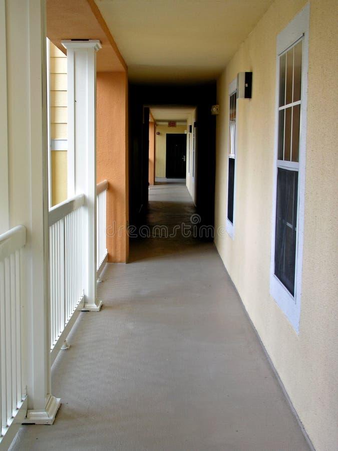 Corridor. Hallway with cement floor and windows stock images