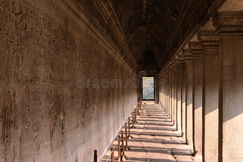 Corridor of Angkor wat temple with carvings status on the wall,. World heritage, Siemreap, Cambodia royalty free stock photos