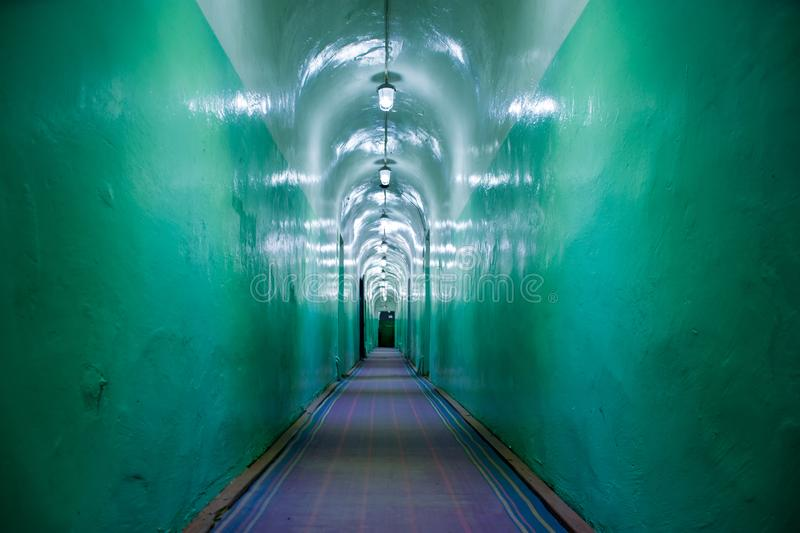 Corridor in asylum, nuclear bomb shelter, military bunker, command headquarters or prison of Soviet Union. Corridor military hoppe royalty free stock photo