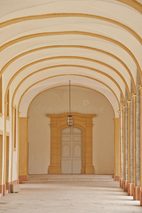 Corridor of a cloister in cluny abbey royalty free stock photography