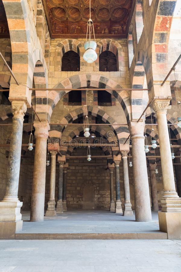 Corridor at the courtyard of the Mosque of al Sultan al Nasir Muhammad Ibn Qalawun, Citadel of Cairo, Egypt. Corridor surrounding the courtyard of the public stock images