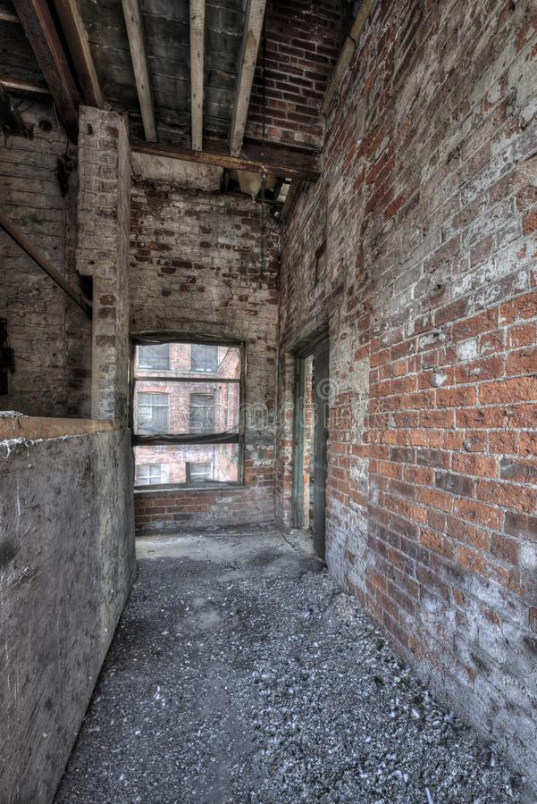 Corridor in derelict building royalty free stock photo