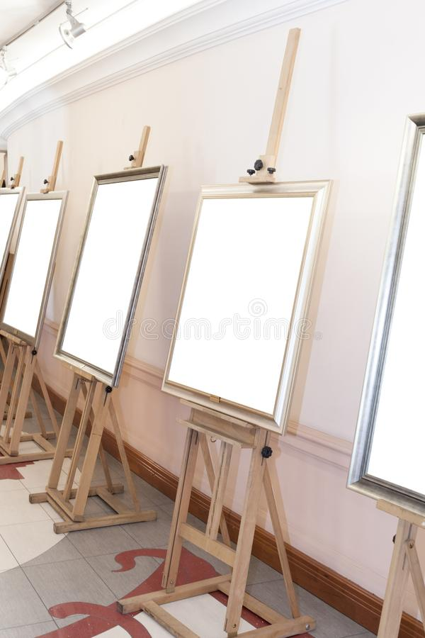 Corridor with blank frames on painting easel. Corridor with empty frames on painting easel stock images