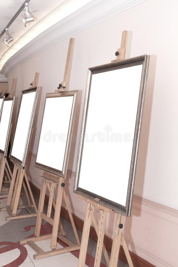 Corridor with blank frames on painting easel. Corridor with empty frames on painting easel royalty free stock images