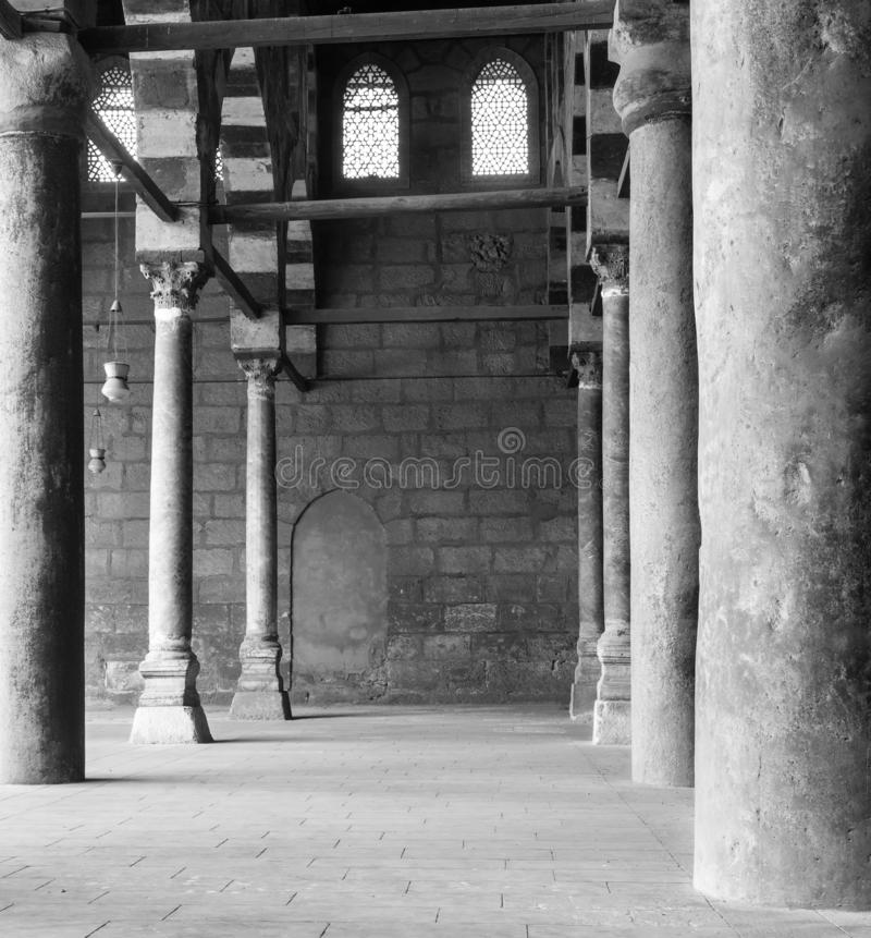 Corridor at historic Mosque of Sultan al Nasir Muhammad Ibn Qalawun, Citadel of Cairo, Egypt. Black and white shot of corridor surrounding the courtyard of stock image
