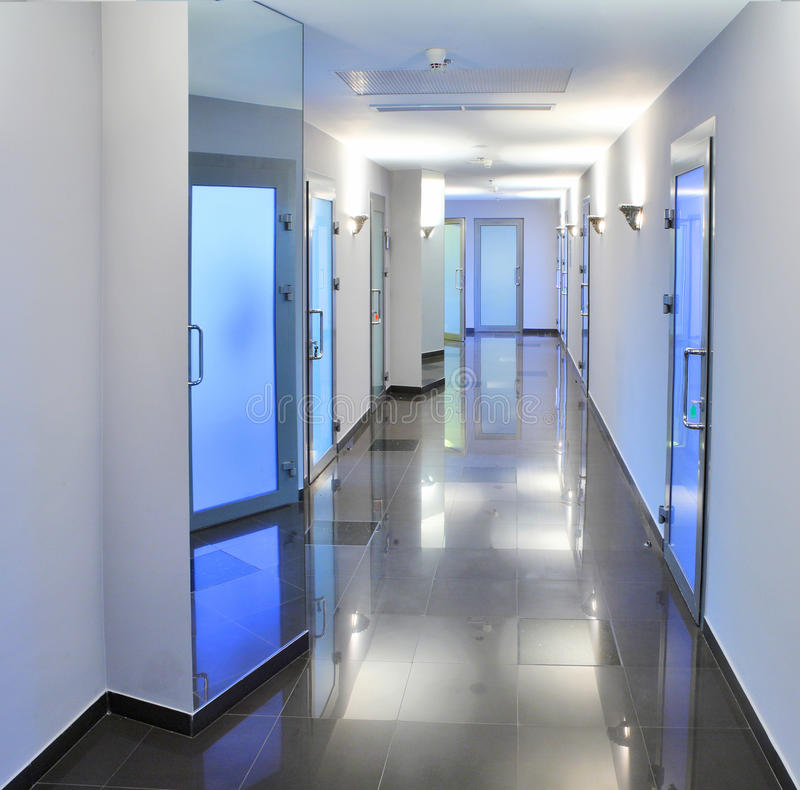Corridor in a hospital building. With mirrows on the walls stock images