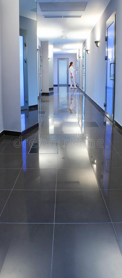 Corridor in a hospital building. With the doctor or nurse at the end stock images