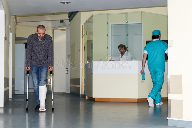 Corridor in a hospital with three persons stock images