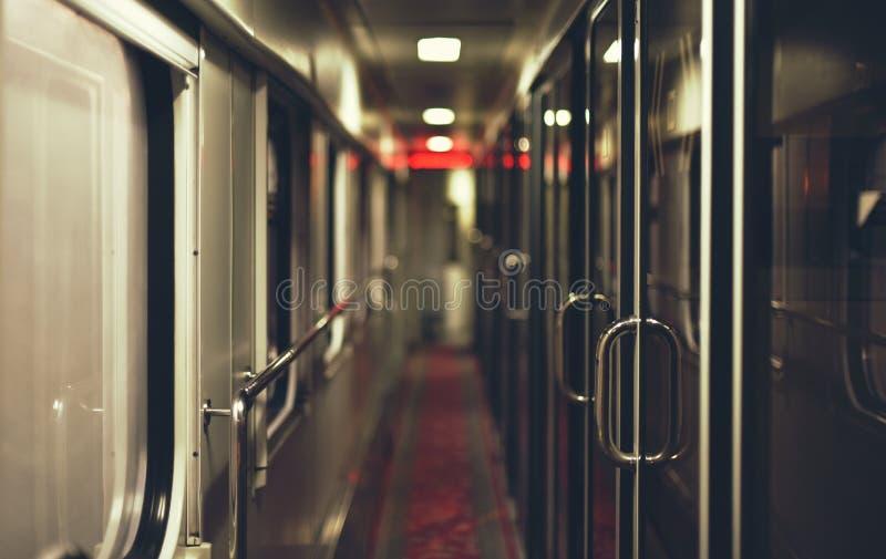 Corridor of intercity train in night. Inside view, corridor of intercity train in night stock photo