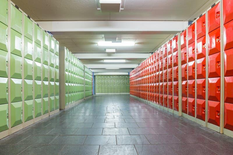 Corridor with lockers in school building. Corridor with red and green lockers in school building stock image