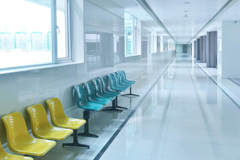 Corridor of modern hospital building. Empty long corridor of modern hospital building royalty free stock image