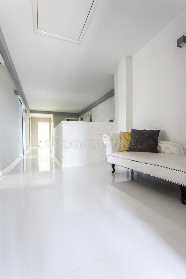 Corridor in a modern luxurious house. White tiled corridor in a modern luxurious house royalty free stock images