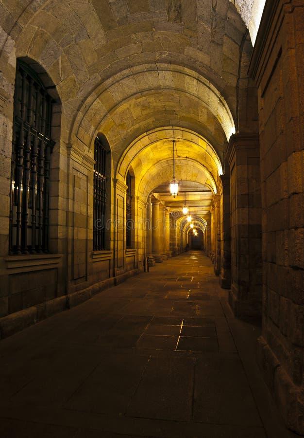 Corridor at night. Corridor of stone with windows at night stock photos