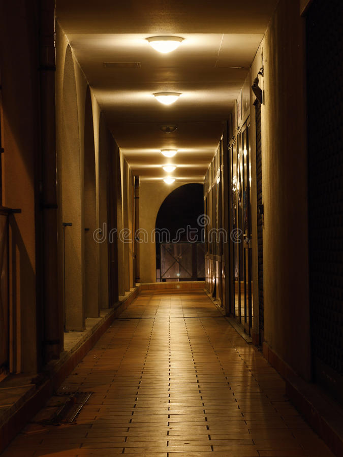 Corridor at night. A corridor of the outside is at night with lamps stock photo