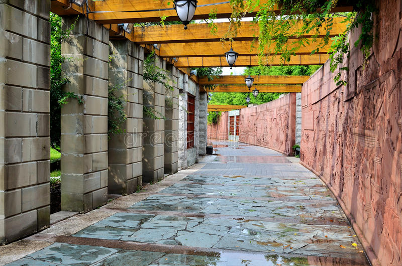 Corridor in park. A corridor with lights in park royalty free stock photo