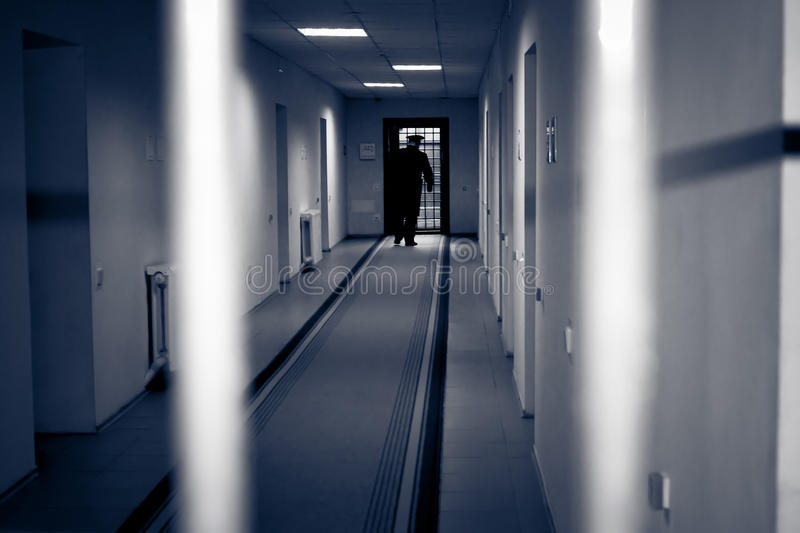 Corridor prison. Picture was taken in a dark key, to emphasize the bleakness of the environment royalty free stock images