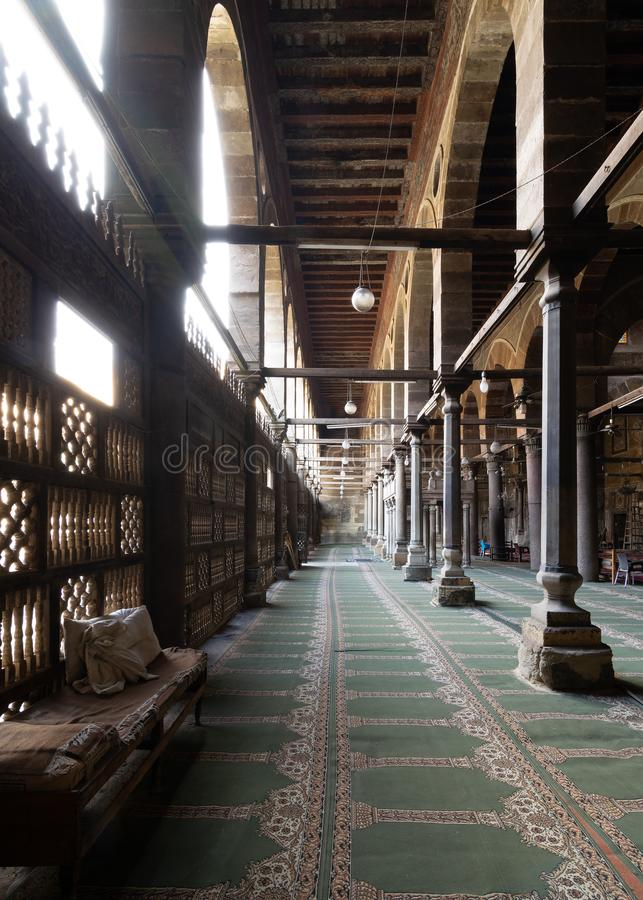 Corridor at public historic mosque of Amir Al-Maridani, Cairo, Egypt. Corridor at public historic mosque of Amir Al-Maridani with wooden arabisk wall stock photo