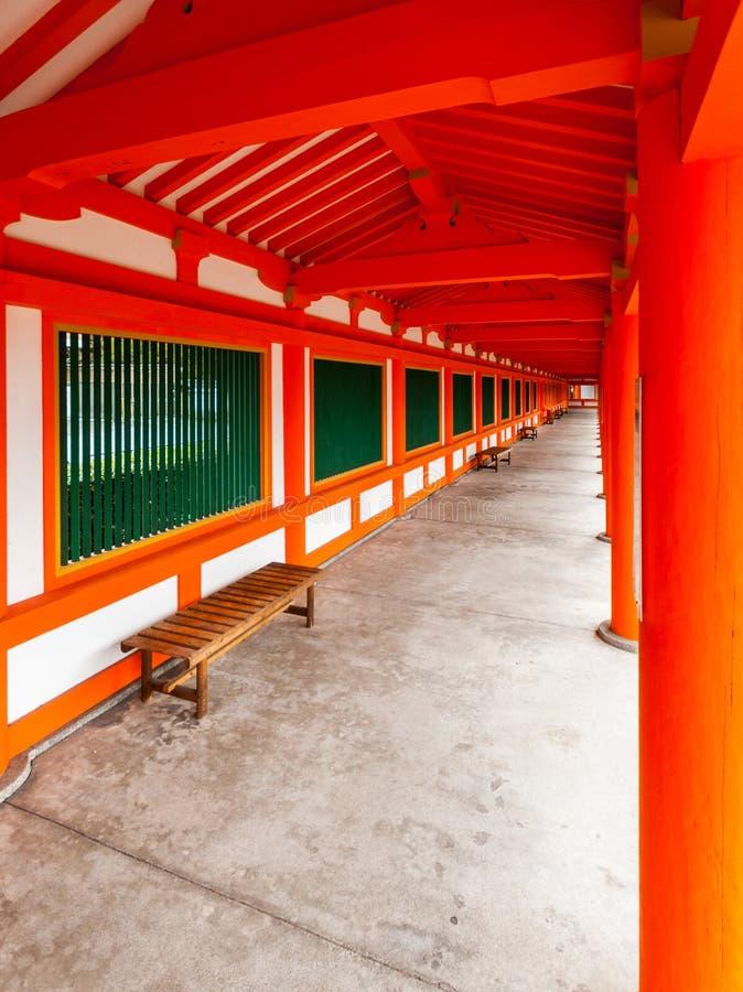 Corridor at Sanjusangen-do temple in Kyoto. Kyoto, Japan - November 20, 2010: Outdoor corridor painted in bright red, part of the Sanjusangen-do temple in Kyoto stock image