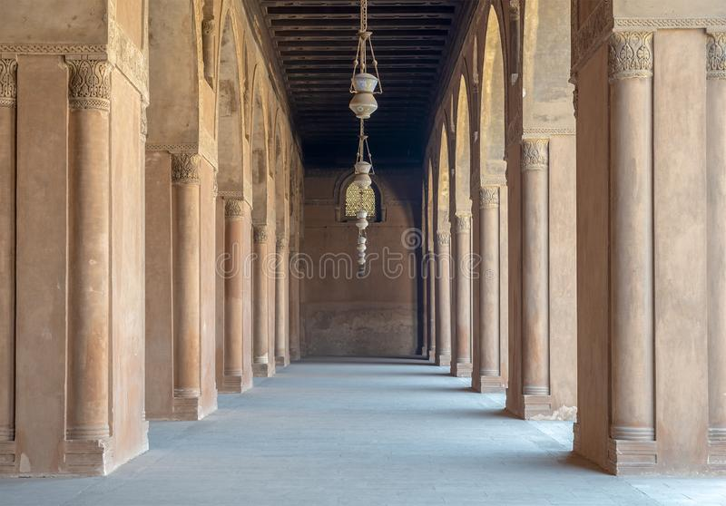 Corridor surrounding the courtyard of the Mosque of Ahmad Ibn Tulun, old Cairo, Egypt royalty free stock images