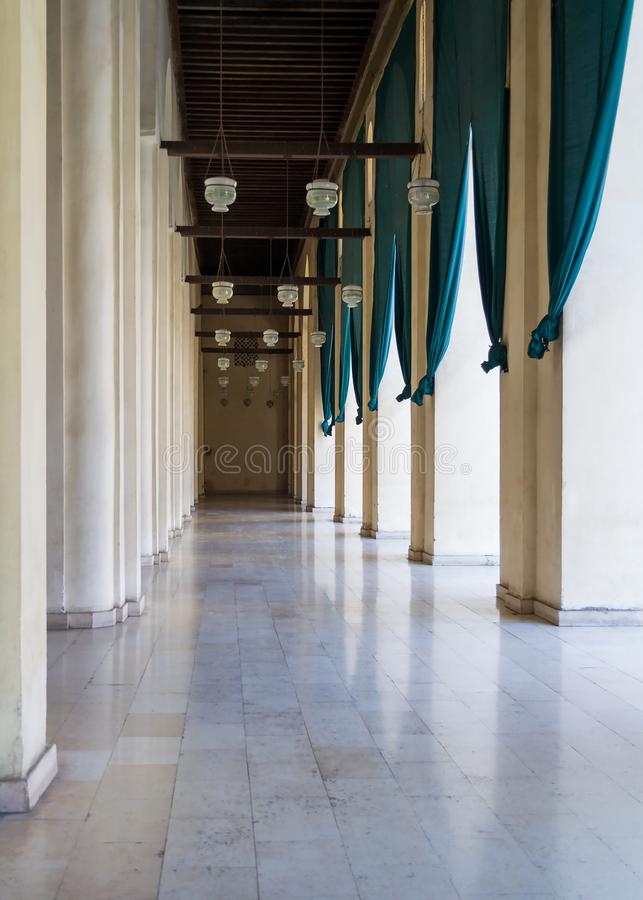 Corridor surrounding courtyard of Al Hakim Mosque known as The Enlightened Mosque, Cairo, Egypt. Corridor surrounding the courtyard of public historic Al Hakim stock photo