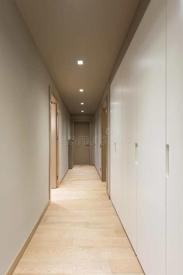 Corridor with white wardrobe. Interior of modern apartment. Nobody inside royalty free stock images