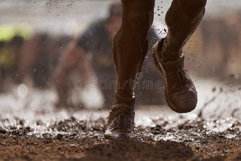 Corridori di corsa del fango immagine stock