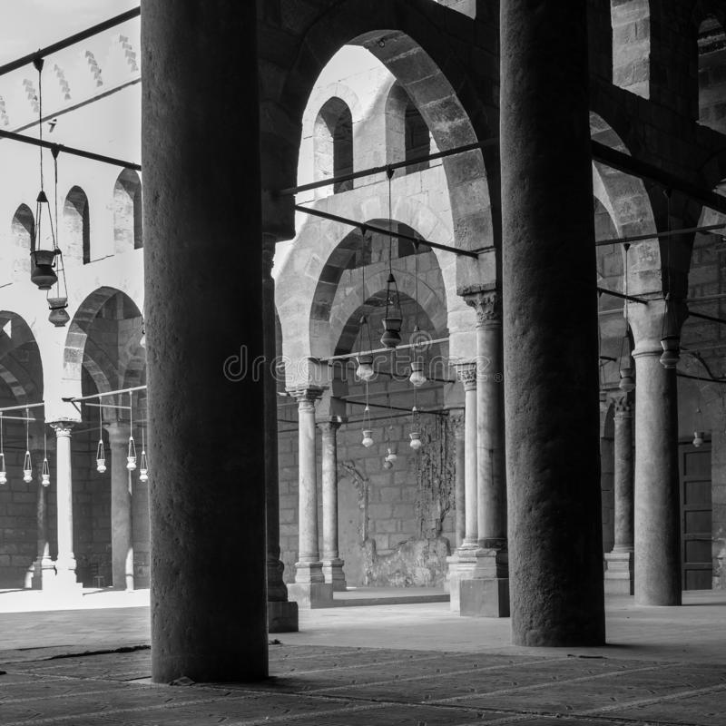 Corridors of historic Mosque of Sultan al Nasir Muhammad Ibn Qalawun, Citadel of Cairo, Egypt. Black and white shot of corridors surrounding the courtyard of stock photo