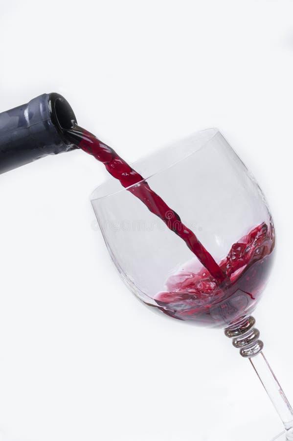 Corriente del vino rojo fotos de archivo