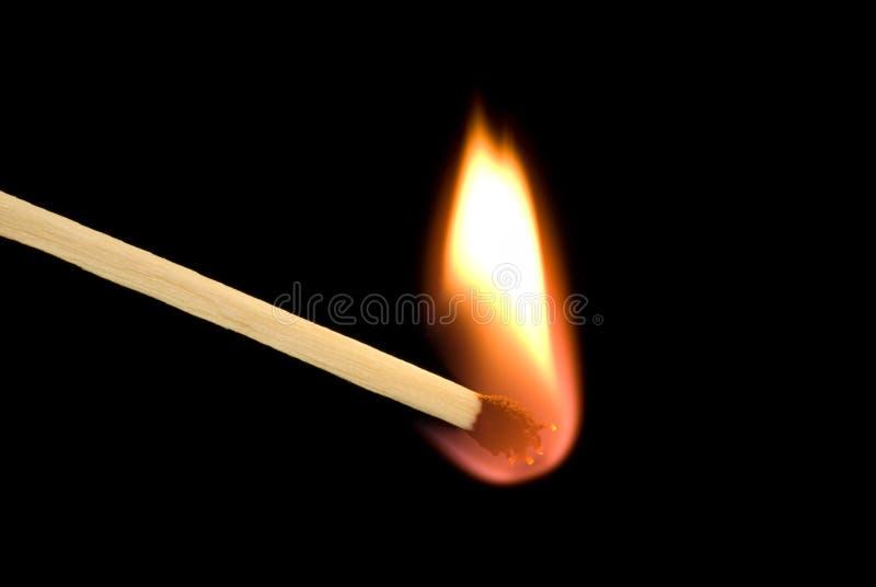 Corrispondenza e fuoco fotografia stock