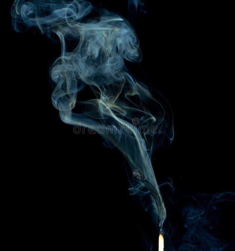 Corrispondenza nel fumo immagine stock libera da diritti