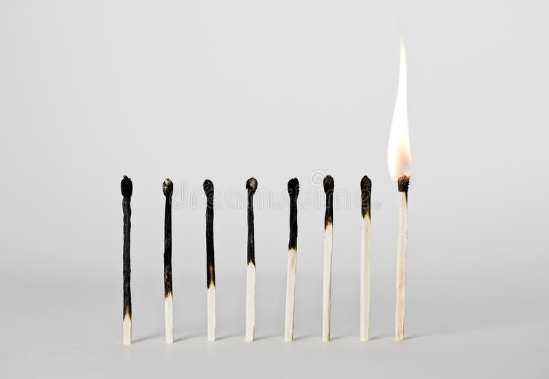 Corrispondenze bruciate immagini stock