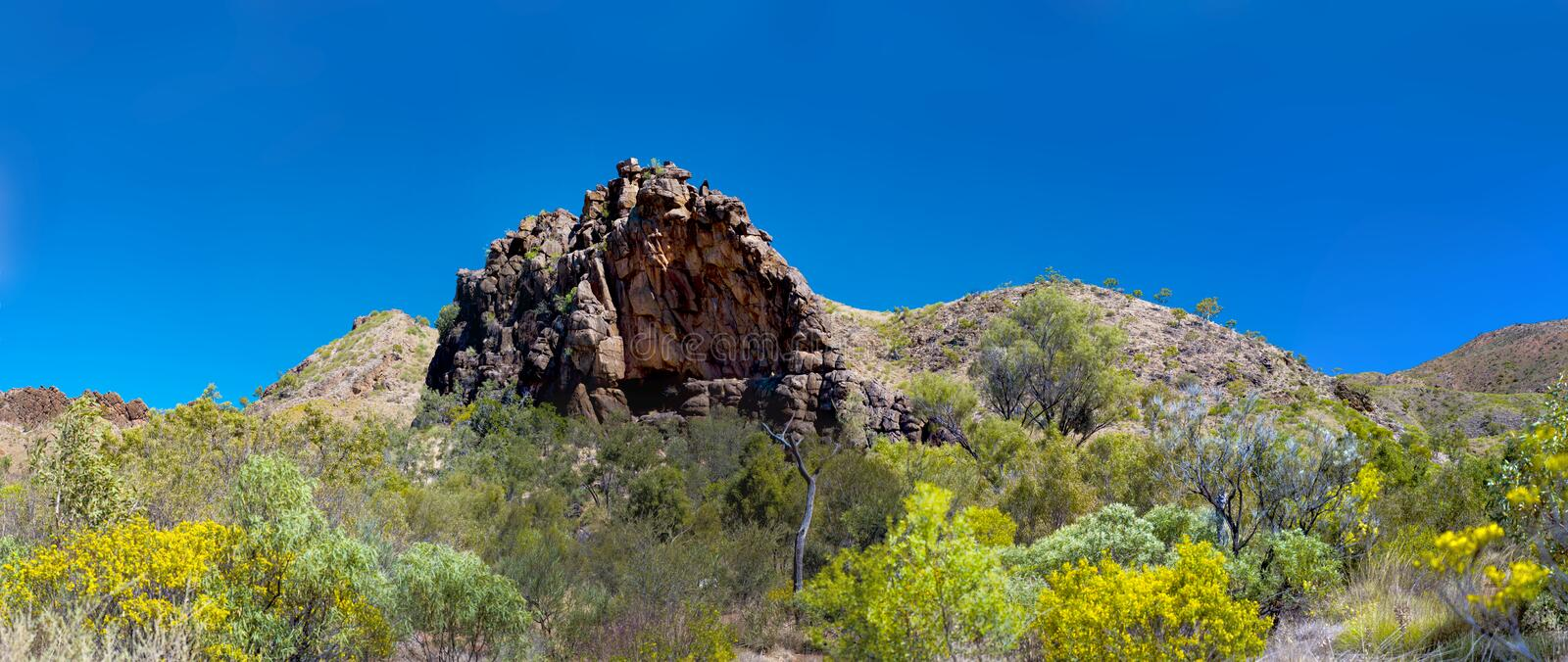 Corroboree Rock. Is a dark grey column of dolomite an hour's drive east of Alice Springs. It is one of many sites in the MacDonnell Ranges that is of great stock photography