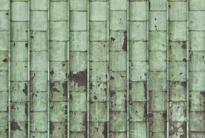 Corroded copper sheets. A background of corroded copper sheets stock photo