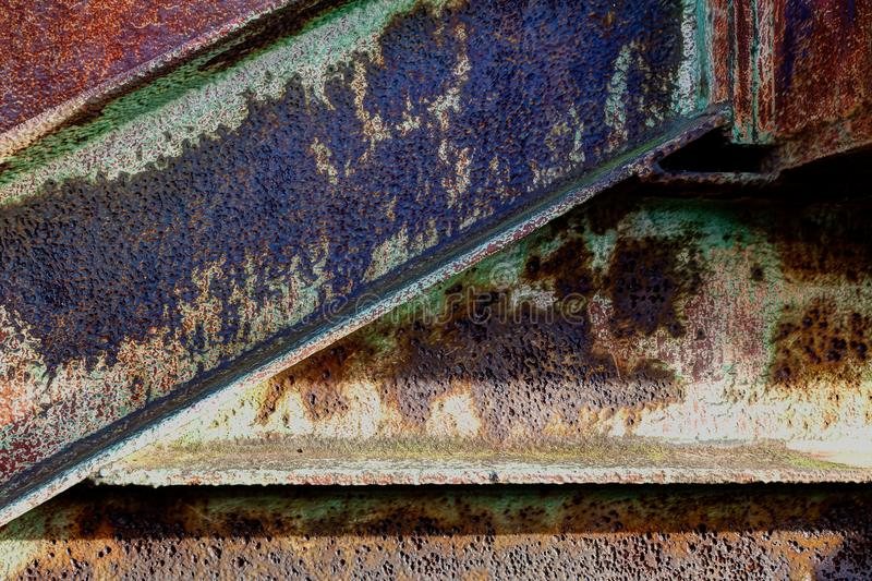 Corroded rusty metal beam background texture. Corroded metal background with aged rust of steel support beams in raking light so the textures comes out nice royalty free stock photography