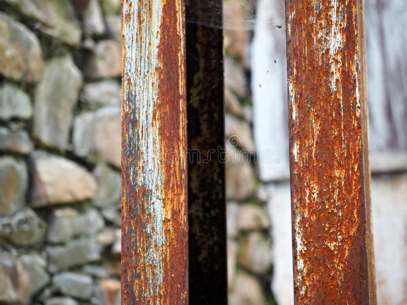 Corroded steel pillars as a background. Rusted white painted metal surface. Corroded steel pillars as a background. Rusted white painted metal surface royalty free stock photos