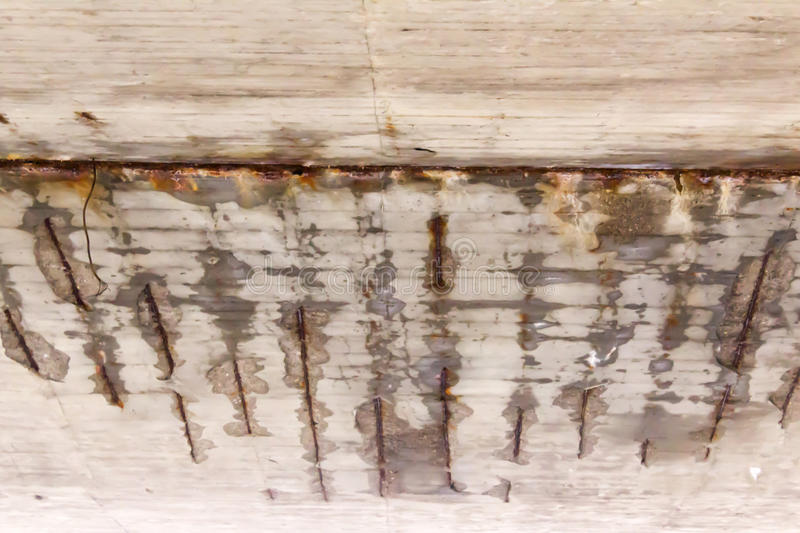 Corrosion of the concrete structure of the bridge due to the precipitation and chemical reagents. stock photography