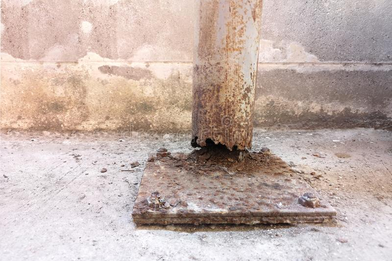 Corrosion and corrosion of steel posts ,cement wall background and empty with copy space for text.  stock photos