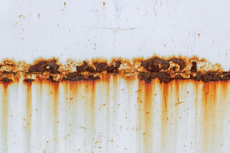 Corrosion of welding seam with red stains on a old white metal sheet. Abstract background royalty free stock images