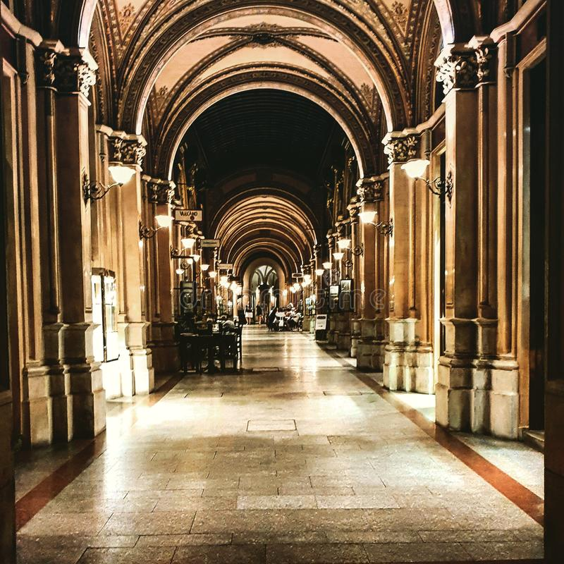 Corrridor. Passageway, lights, antique, nopeople, chairs, old, building royalty free stock photo