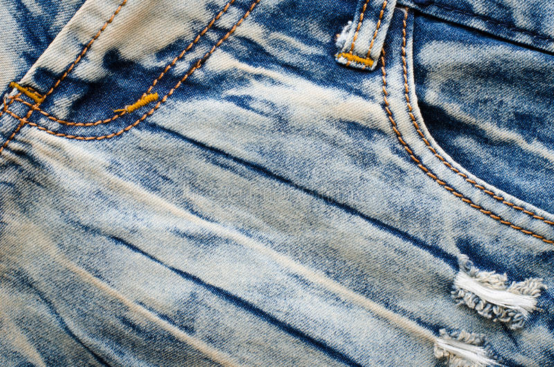 Corruga la struttura delle blue jeans Priorità bassa dei jeans fotografie stock