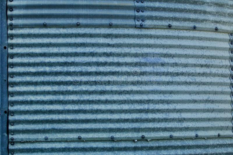 Corrugated blue galvanized steel bin sections stock photography