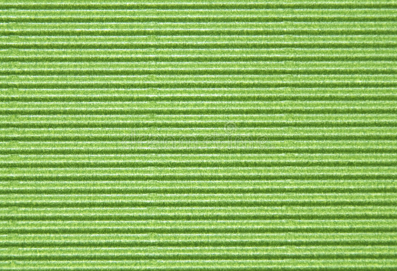 Corrugated cardboard. Close-up of green corrugated cardboard - texture series royalty free stock photography