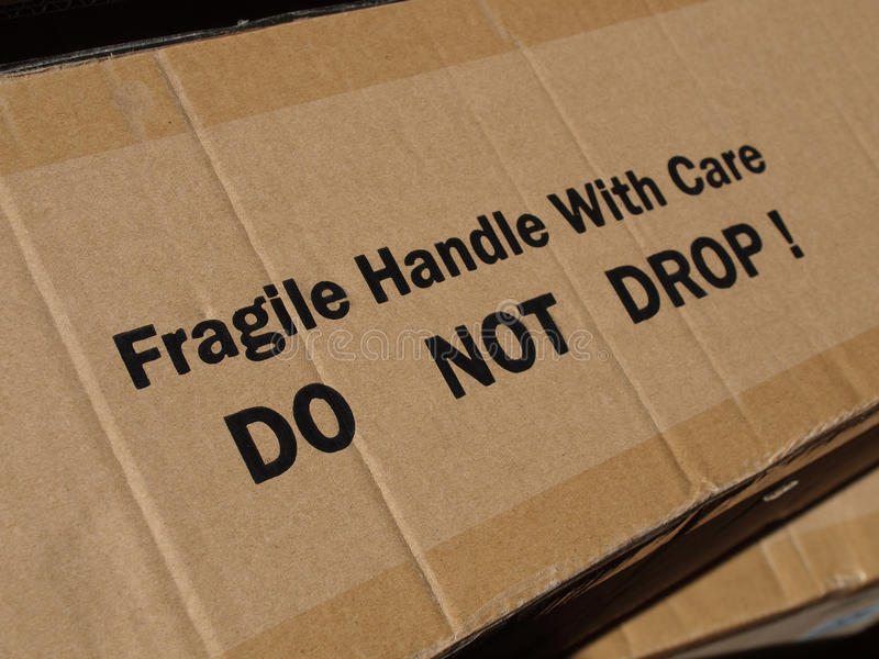 Corrugated cardboard. Fragile Handle with Care Do not drop label on a corrugated cardboard box stock image